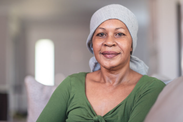 Portrait of a contemplative woman with cancer